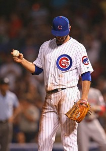 Jonathan Daniel/Getty Images Jake Arrieta reacts after losing a no-hit bid in the 7th inning against the Cincinnati Reds at Wrigley Field Tuesday night.