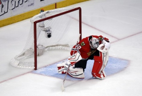 Charles Rex Abrogast/Associated Press Hawks goalie Corey Crawford looks down after giving up the game-winning goal of Game 7 of the Western Conference Finals Sunday night.