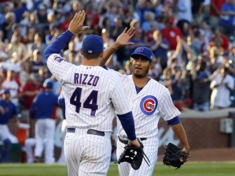 Charles Rex Arbogast/AP Anthony Rizzo and Hector Rendon celebrate the Cubs' 7-6 win over St. Louis Friday night.