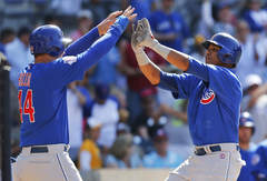 Lenny Ignelzi/AP Anthony Rizzo and Starlin Castro have paired up to give the Cubs some hope for the future, but they need help.