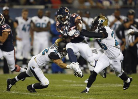 Andrew Nelles/AP Chicago Bears running back Ka'Deem Carey (25) runs between Jacksonville Jaguars defenders Chris Prosinski (42) and safety Sherrod Martin, right, during the second half of last Thursday's preseason game at Soldier Field.