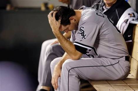Ted S. Warren/AP White Sox starter Scott Carroll sits in the dugout after getting yanked in the sixth inning of Chicago's loss Thursday at Seattle.