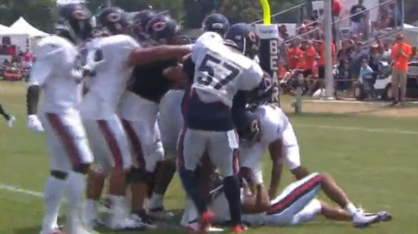 WGN-TV Martellus Bennett, Kyle Fuller and a host of other Bears, mid-scuffle, during the Chicago Bears' most infamous run-in during this year's training camp.