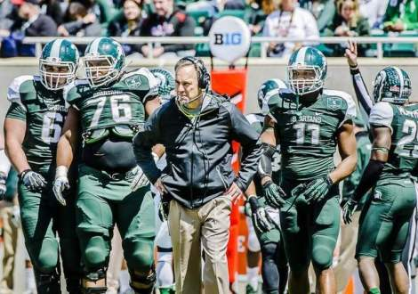 Kevin W. Fowler/Lansing State Journal Michigan State head coach Mark Dantonio (center) watches his team perform during the MSU Spring football game. The Spartans are the defending Big Ten Champions and a possible National Championship contender.