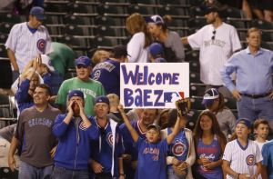 Chris Humphreys/USA Today Sports An excited group of Cubs fans in Denver roll out the blue carpet for hyped rookie Javier Baez earlier this week.