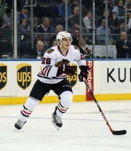 Bruce Bennett/Getty Images Ben Smith, here skating in the preseason against New York, stands to be a key contributor among the Chicago Blackhawks' up-and-coming talent this season.