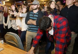 Richard W. Rodriguez/AP TCU students react to the news Sunday that their team did not make the inaugural College Football Playoff.