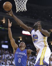Associated Press  Draymond Green, right, blocks a shot from Oklahoma City Thunder guard Russell Westbrook in a January contest.