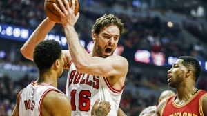 Gasol grabs a rebound over Cleveland Cavaliers forward Tristan Thompson and Derrick Rose in the first half of a fame early this season.