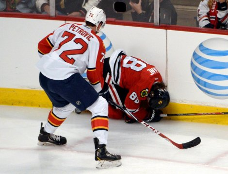 David Banks/USA Today Sports  Patrick Kane curls up in pain after initially breaking his collarbone in action late February.
