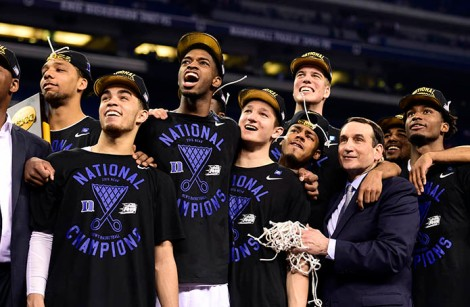 "Duke Blue Devils head coach Mike Krzyzewski and his players including Quinn Cook watch ""One Shining Moment"" after defeating the Wisconsin Badgers in the 2015 NCAA Men's Division I Championship game at Lucas Oil Stadium. (USA TODAY Sports)"
