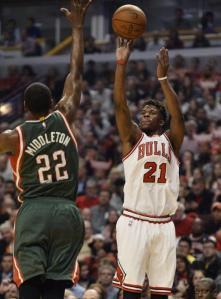 Brian Kersey/UPI Jimmy Butler offers up a long-range shot as part of his career-high 31-point playoff effort in Game 2 of the Bulls opening round series with the Bucks.