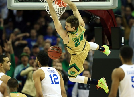 Notre Dame Fighting Irish guard/forward Pat Connaughton (24) dunks ahead of Kentucky Wildcats forward Karl-Anthony Towns (12) during the second half in the finals of the midwest regional of the 2015 NCAA Tournament at Quicken Loans Arena. (USA TODAY Sports)