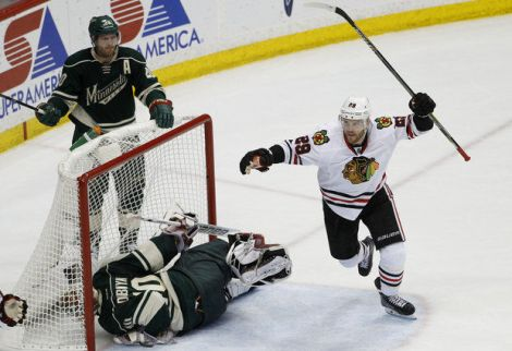 Associated Press Chicago Blackhawks left wing Bryan Bickell (29) celebrates after right wing Patrick Kane scored on Wild goalie Devan Dubnyk (40) during the third period of Game 4 in the Hawks' series sweep of Minnesota.