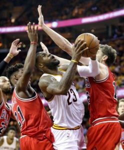 Tony Dejak/AP  The Bulls put the squeeze on LeBron James and the Cleveland Cavaliers in winning Game 1 of their playoff series Monday night.