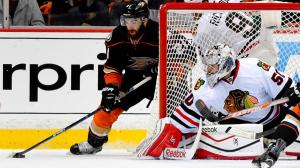 Mark J. Terrill/AP The Anaheim Ducks' Kyle Palmieri, left, prepares to shoot against Corey Crawford in Game 2 Tuesday night.