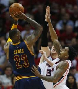Associated Press Lebron shoots over Mike Muscala and Jeff Teague during Game 1 Wednesday night.