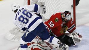 Charles Rex Arbogast/AP Chicago Blackhawks goalie Corey Crawford, right, stops a shot by Tampa Bay Lightning's Nikita Kucherov during the second period in Game 3 of the Stanley Cup Final Monday night.