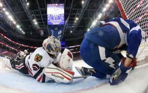 Bruce Bennett/AP Chicago Blackhawks goalie Corey Crawford collides in the goal with Tampa Bay Lightning right wing Nikita Kucherov during the first period of Game 5 of the Stanley Cup Final Saturday in Tampa.