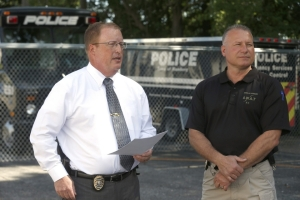 Robert Kirkham/Buffalo News Town of Hamburg Police Chief Gregory Wickett, left, standing with Capt. Peter Dienes, released a statement outside their facility Friday on South Park Avenue about the ongoing investigation involving NHL star Patrick Kane.