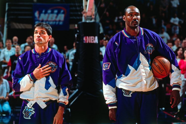 HOUSTON - MAY 25:  John Stockton #12 and Karl Malone #32 of the Utah Jazz stands for the National Anthem prior to Game Four of the Western Conference Finals against the Houston Rockets during the 1997 NBA Playoffs at the Compaq Center on May 25, 1997 in Houston, Texas. The Rockets won 95-92. NOTE TO USER:User expressly acknowledges and agrees that, by downloading and/or using this Photograph, user is consenting to the terms and conditions of the Getty Images License Agreement. Mandatory Copyright Notice: Copyright 1997 NBAE (Photo by Glenn James/NBAE via Getty Images)