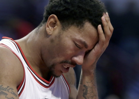 FILE- In this Nov. 10, 2014, file photo, Chicago Bulls guard Derrick Rose holds his head after being fouled during the second half of an NBA basketball game against the Detroit Pistons in Chicago. The news that Derrick Rose will have knee surgery again hit the Chicago Bulls and their fans hard and left them in a familiar spot _ trying to get by without their star point guard. The torn meniscus in his right knee was announced Tuesday night, Feb. 24, 2015, another tough twist for a franchise, a star, his sponsors and a fanbase that thought the Bulls were entering another golden era just a few years ago. (AP Photo/Charles Rex Arbogast, File) ORG XMIT: NY173
