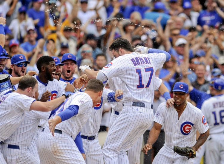 Chicago Cubs' Kris Bryant celebrates his walk off home run during the ninth inning of a baseball game against the Cleveland Indians on Monday, Aug. 24, 2015, in Chicago. The Cubs beat the Indians  2-1.  (AP Photo/Matt Marton)