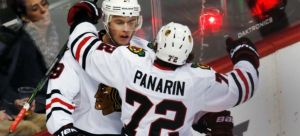 The Canadian Press Artemi Panarin celebrates with Jonathan Toews after an OT goal to beat Colorado earlier this month.