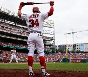 Nick Wass/Associated Press Washington Nationals' Bryce Harper warms up on deck during a baseball game against the Cincinnati Reds July 3 in Washington.