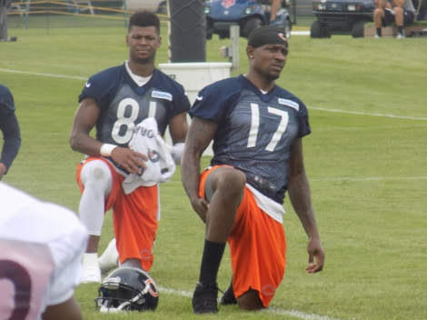 Credit: Kevin Offett Chicago Bears receivers Alshon Jeffrey (17) and Cameron Meredith stretch during a recent practice at training camp in Bourbonnais, Ill. The Bears' receiving corps has been particularly hit with injury early in the team's preseason camp schedule.