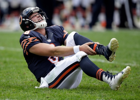 Chicago Bears quarterback Connor Shaw (8) holds his leg after getting hurt on a play during the second half of an NFL preseason football game against the Kansas City Chiefs, Saturday, Aug. 27, 2016, in Chicago. The Chiefs won 23-7. (AP Photo/Tom Lynn)