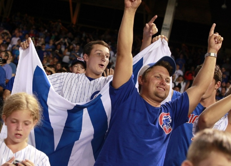 Aug 16, 2016; Chicago, IL, USA; Chicago Cubs fans cheer after the Cubs defeated the Milwaukee Brewers at Wrigley Field. Mandatory Credit: Caylor Arnold-USA TODAY Sports