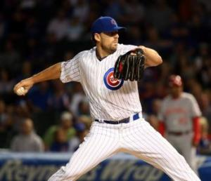 Chicago Tribune John Lackey in action in the Cubs' 9-2 victory Wednesday night against Cincinnati at Wrigley Field.