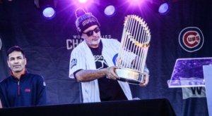 Kristin Decker/WGN Radio Joe Maddon getting acquainted with the World Series trophy.