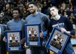 Minnesota Timberwolves players, from left, Andrew Wiggins, Karl-Anthony Towns and Zach LaVine hold photos during a presentation honoring them for their accomplishments at the NBA All-Star Weekend at an NBA basketball game against the New York Knicks, Saturday, Feb. 20, 2016, in Minneapolis. (AP Photo/Jim Mone)